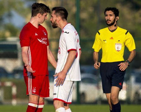 Aberdeen''s Kenny McLean is confronted.