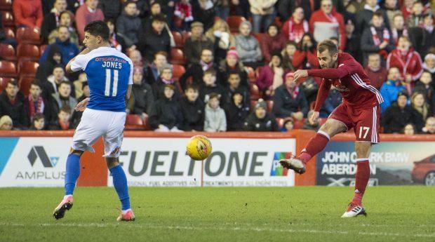 Aberdeen's Niall McGinn makes it 3-1 against Kilmarnock.