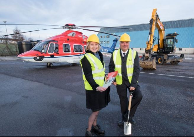 OGUK chief executive Deirdre Michie and CHC regional director Mark Abbey breaking ground as the revamp of CHC's heliport gets under way.