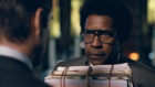 Colin Farrell as George Pierce and Denzel Washington as Roman J. Israel, Esq.