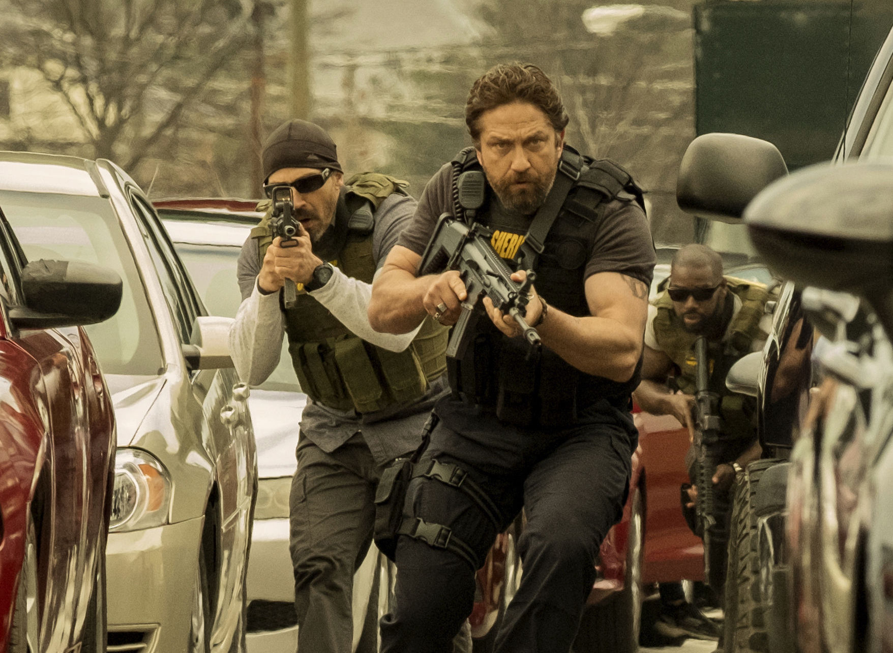 Jay Dobyns as Wolfgang and Gerard Butler as Detective Nick O'Brien.