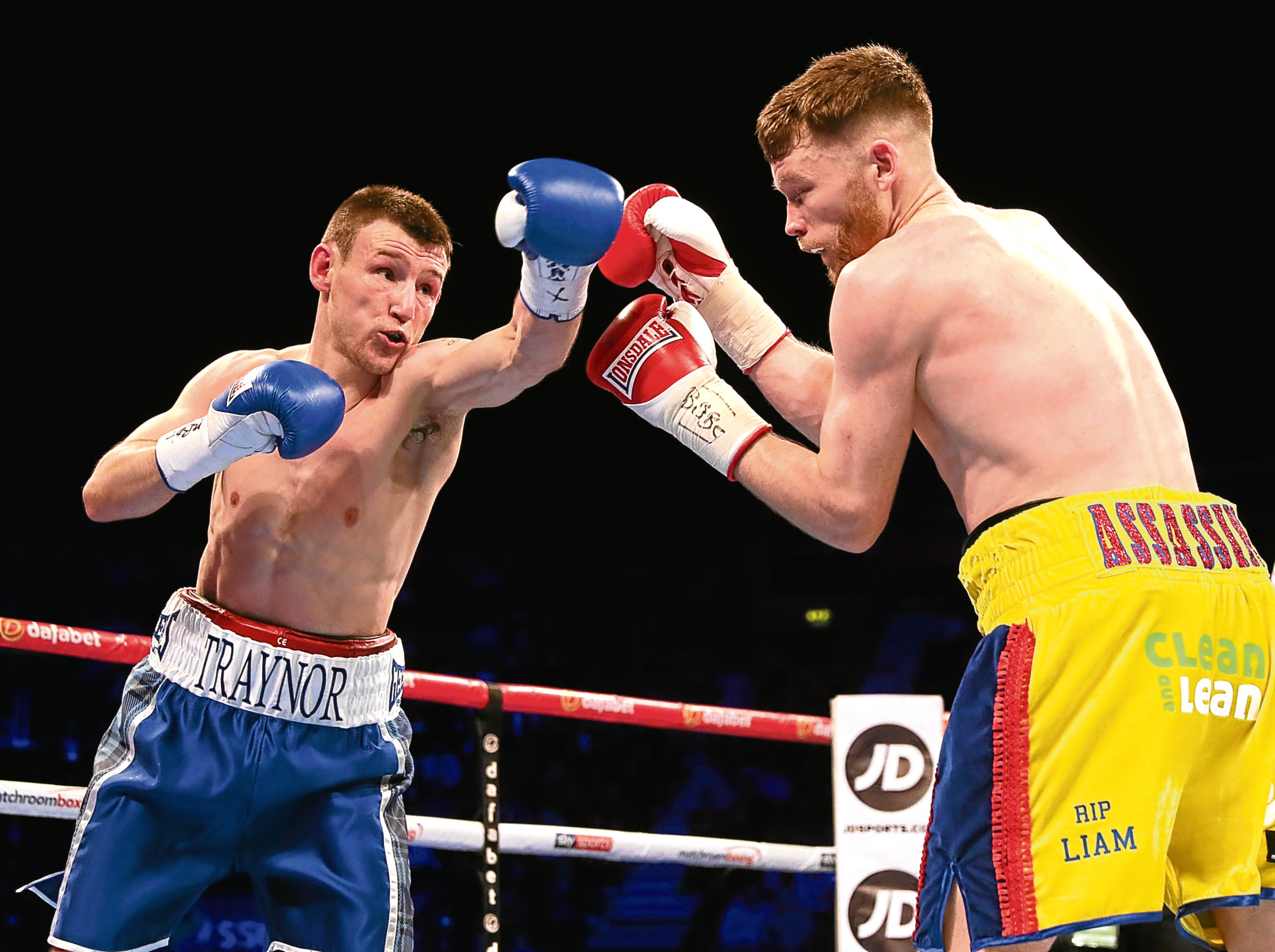 Darren Traynor, left, in action against James Tennyson during their WBA International Super-Featherweight Championship at the SSE Arena, Belfast.