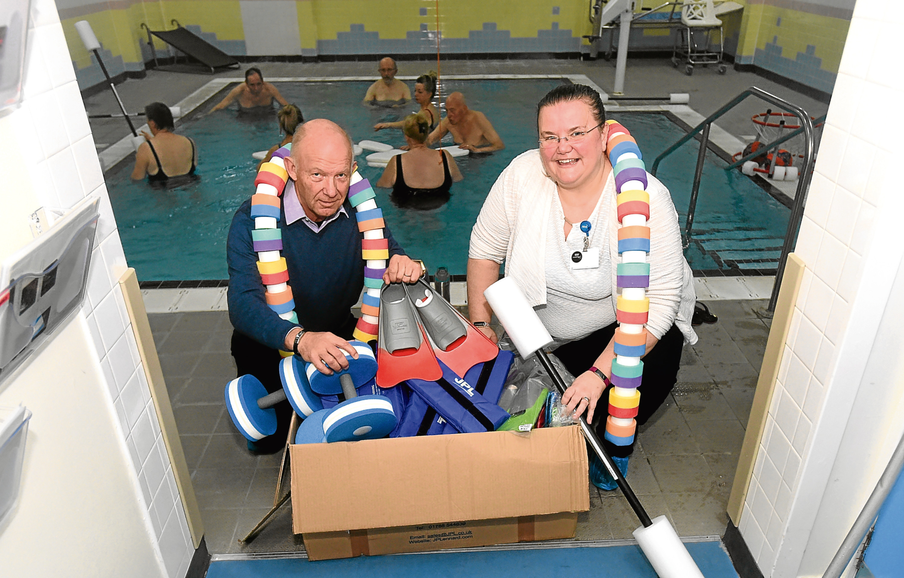 Peter Fogiel and Catriona Cameron with the donated equipment