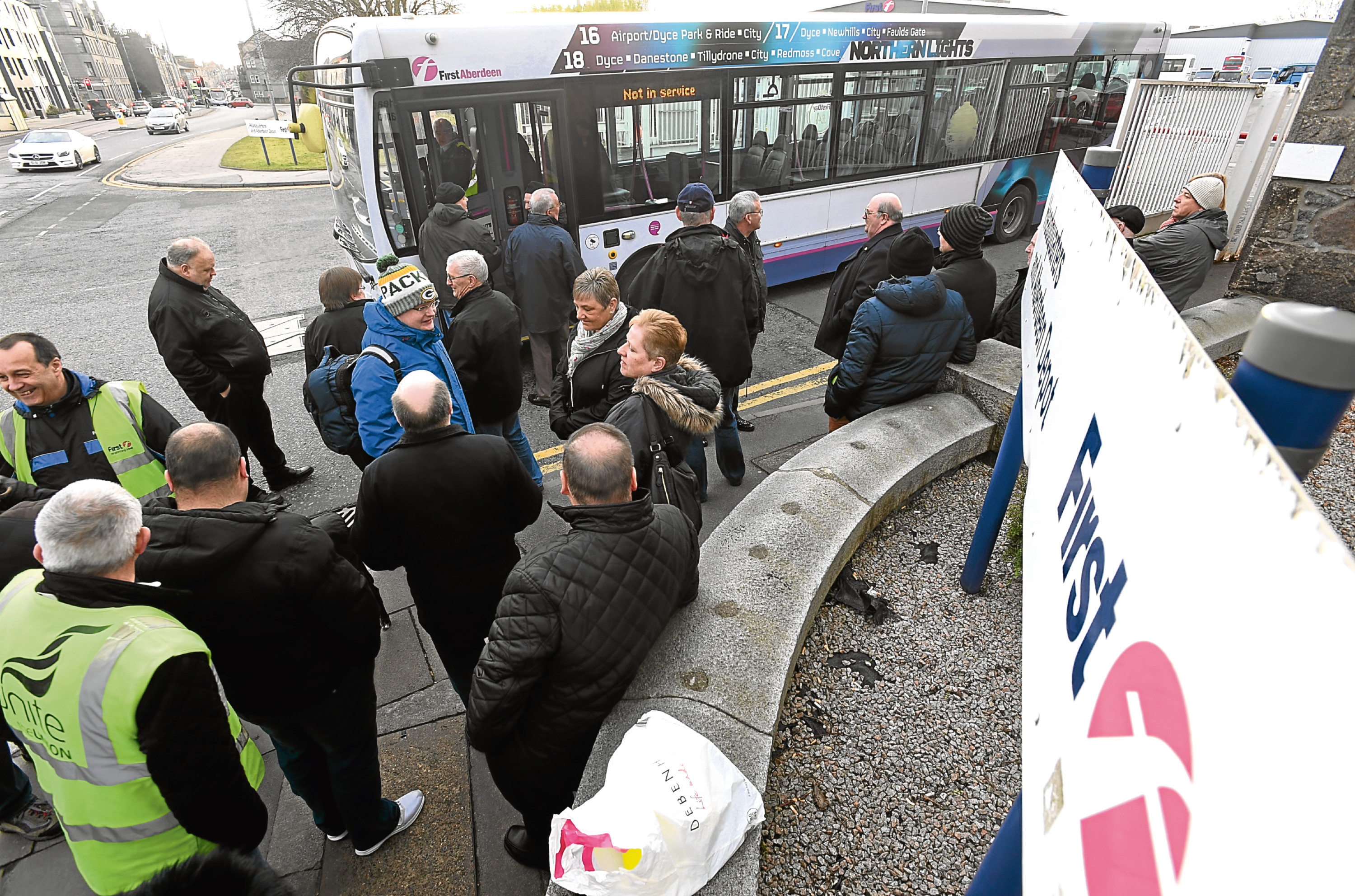 Bus drivers, their families and retired drivers protested about terms and conditions of new contracts at First Bus Aberdeen deport on Sunday.