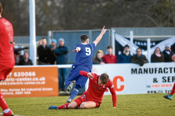 Megginson celebrating after scoring an equaliser for his side to make it 1-1. Picture by Darrell Benns