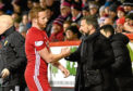 Aberdeen's Adam Rooney shakes hands with manager Derek McInnes after being subbed.