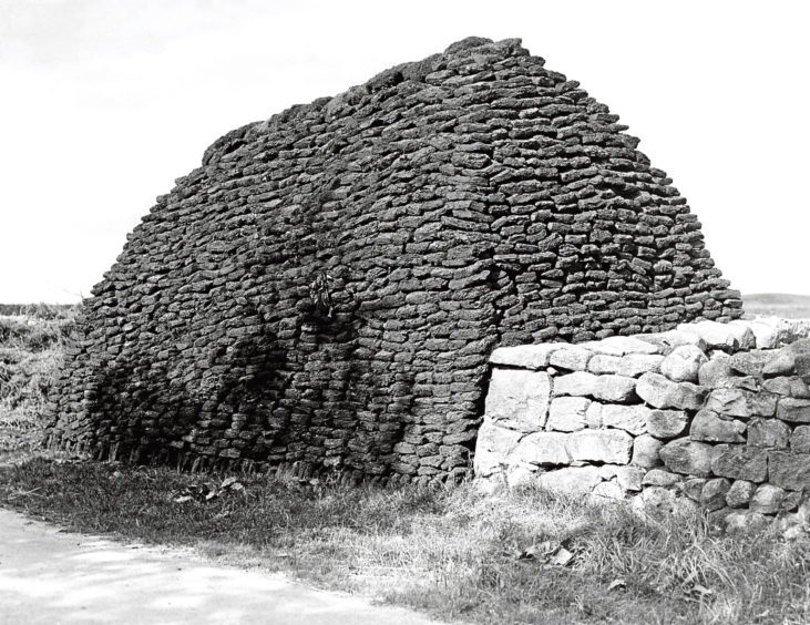 1930s: Peats at the side of the road near Aberdeen.
