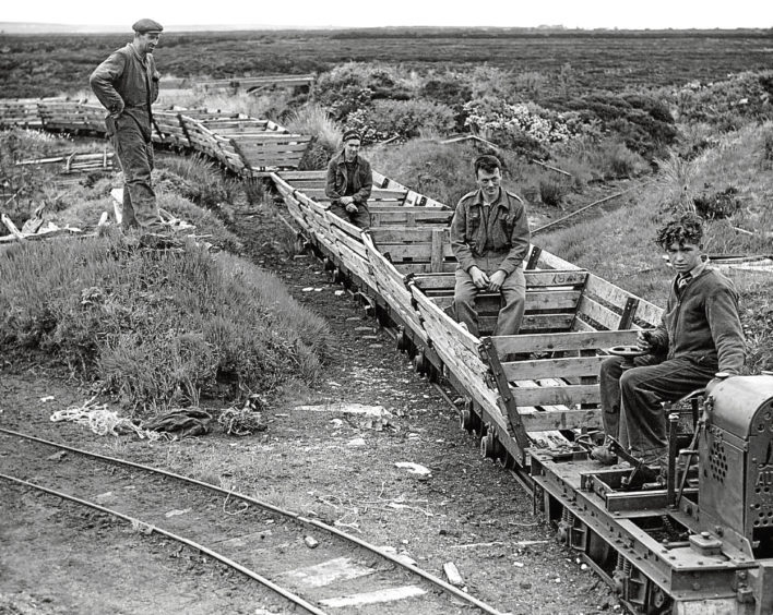 1947: Workers prepare to transport the peat.