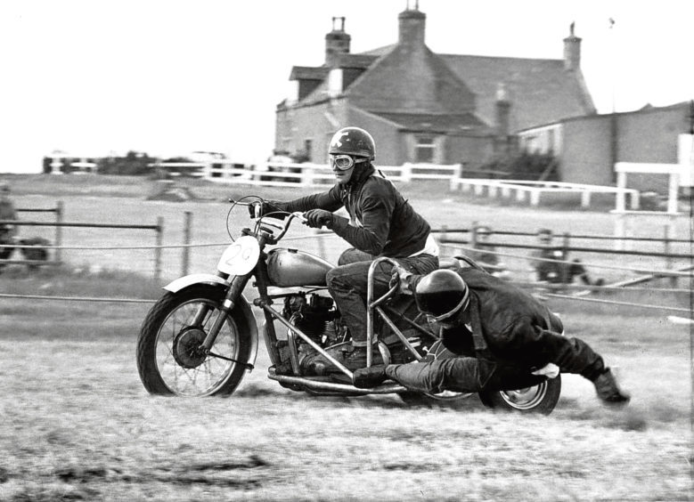 1969: A sidecar racer keeps his balance during a grass track meeting at the Royal Northern Showground, Bridge of Don.