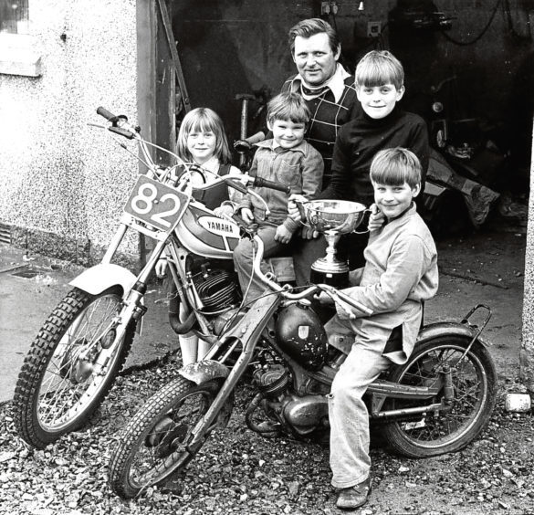 1979: Peter Mitchell shows off his Scottish Motorcyle Six-day Trial Trophy to his children, from left, Alison, Duncan, Stuart and Derek.