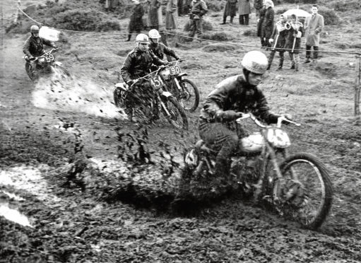 1962: The mud goes flying into the air during a motorcycle race at Newburgh.