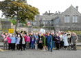 People from the Torry community gathered outside the Victoria Road school.