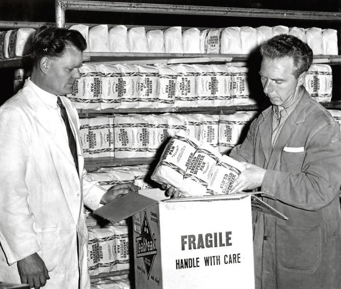 1961: J Hopkins, left, and P Gray, Northern Co-op, pack bread to be sent to Russia.