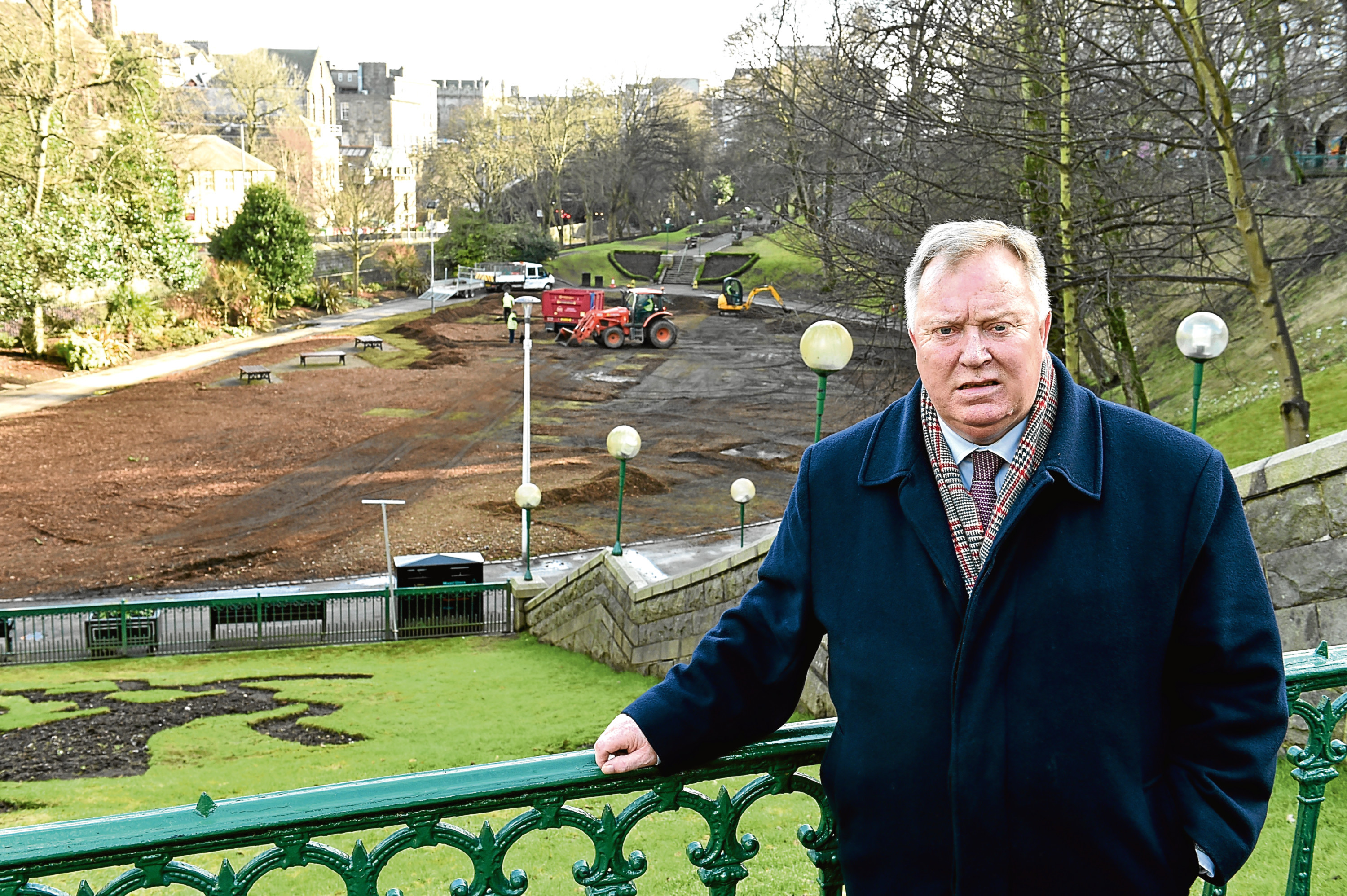 Union Terrace Gardens getting tidied up after SPECTRA leaving bark over the grass. Councillor Bill Cormie is complaining about the mess. Picture by COLIN RENNIE   February 20, 2018.