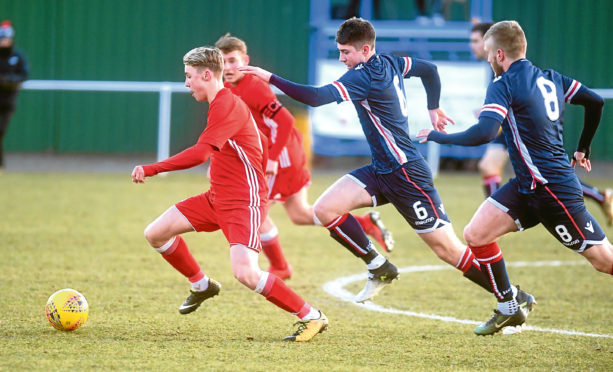 Aberdeen Under-20s v Ross County Under-20s in the quarter final of the Scottish Youth Cup. Aberdeen's Ethan Ross and Ross County's Mark Gallaple.