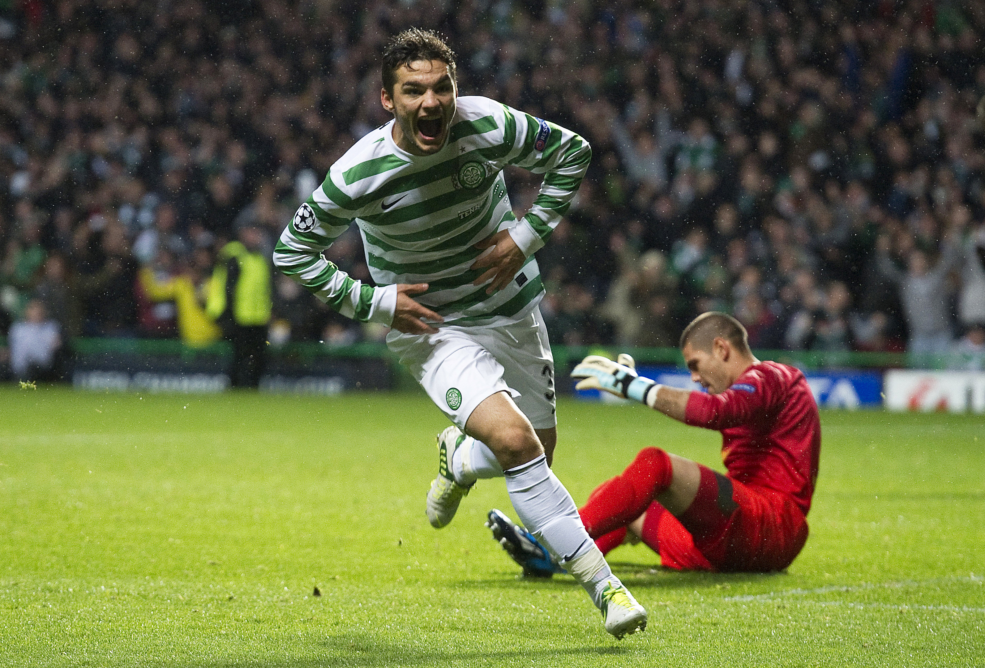 Tony Watt charges off to celebrate his winner against Barcelona in 2012.
