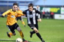 Fraserburgh's Paul Young (right) in action.