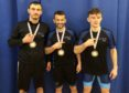 Left to right, Ianic Sacultan, Vio Etko and Nico Cojocaru with their medals.
