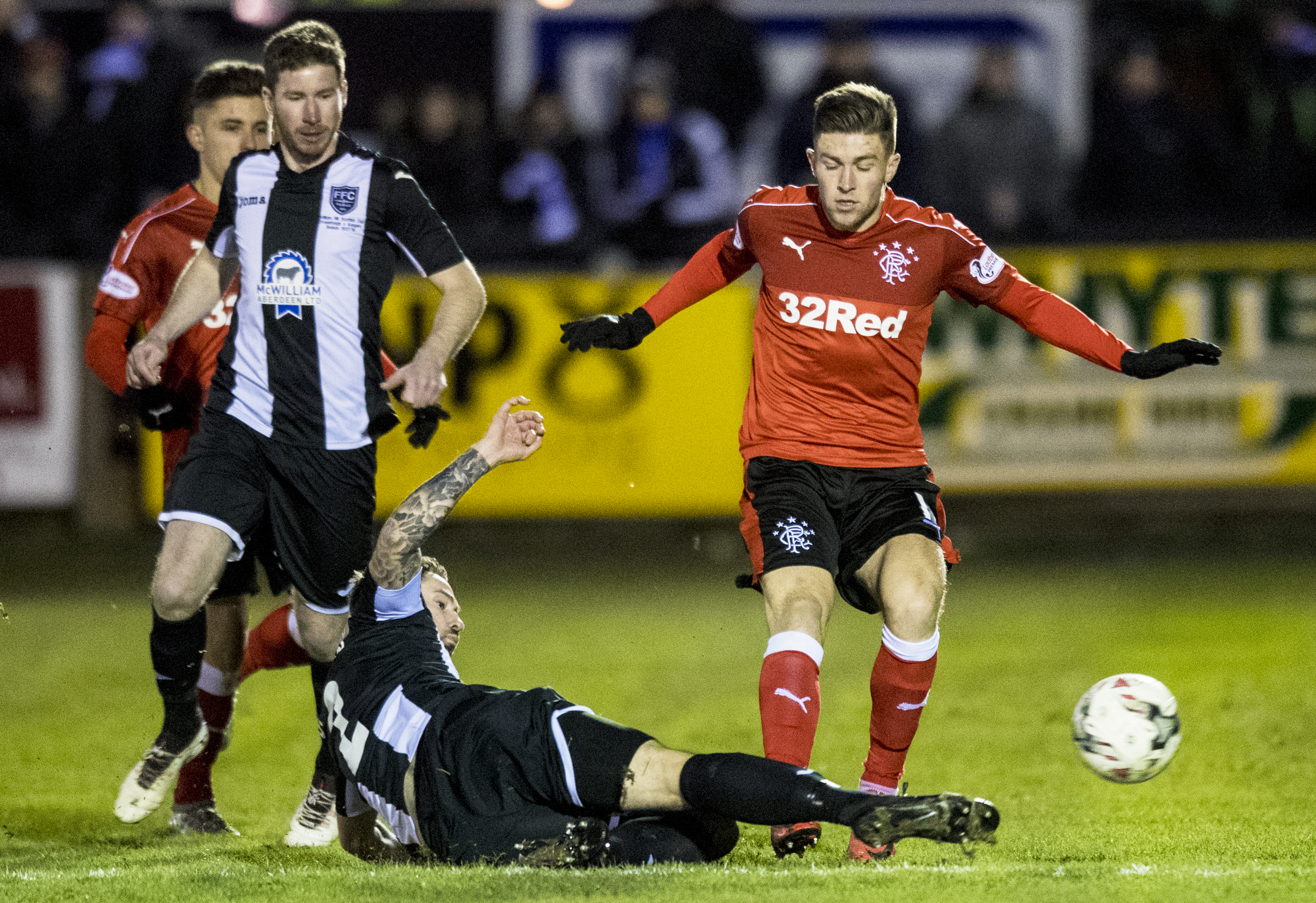 Rangers' Josh Windass, left, is tackled by Marc Dicks.