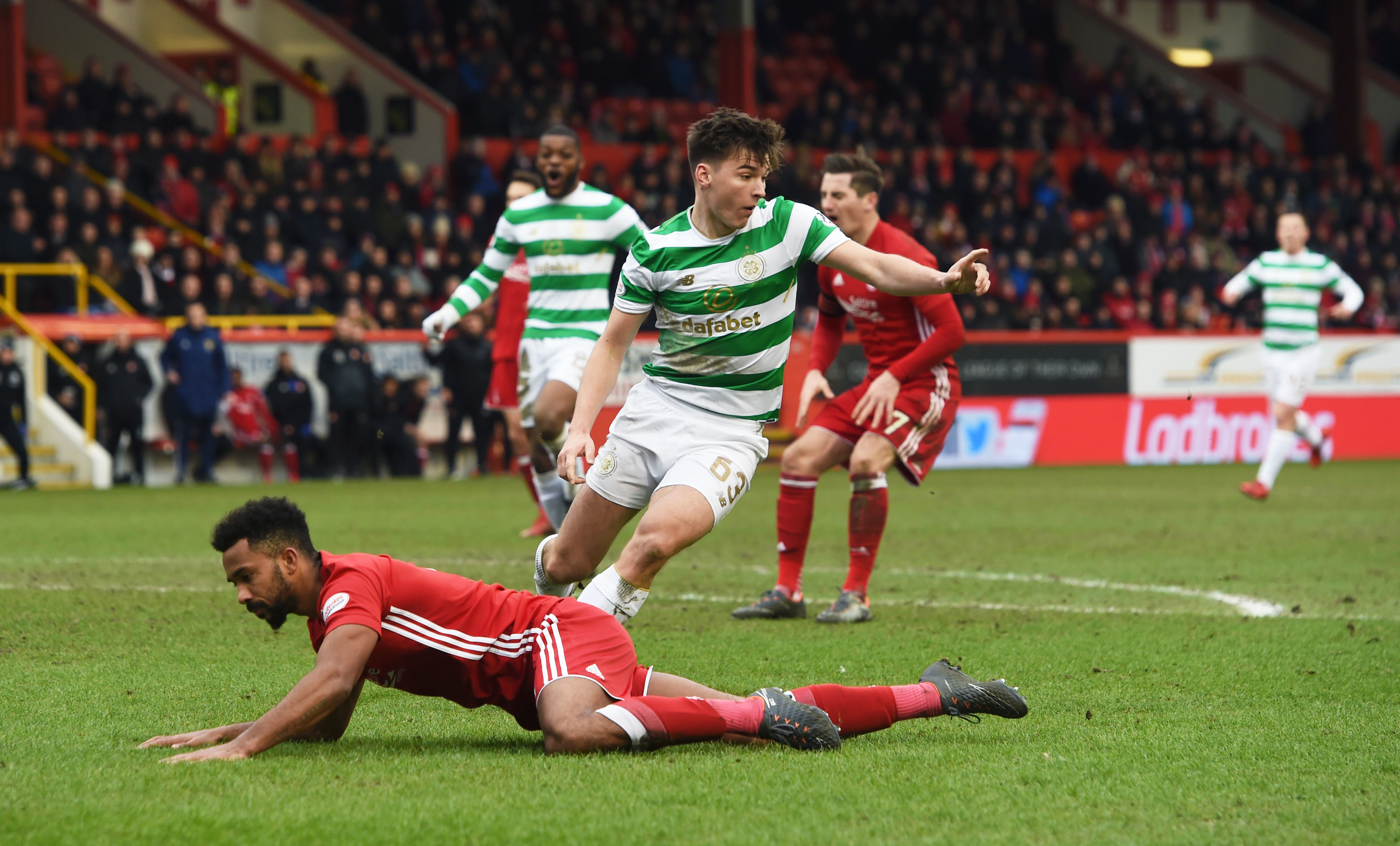 Celtic's Kieran Tierney in action with Aberdeen's Shay Logan.