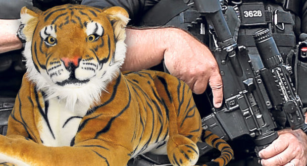 A near life-size stuffed tiger, similar to the one pictured, attracted armed officers