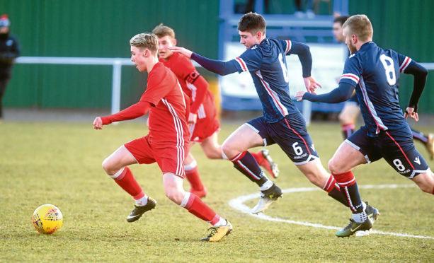 Aberdeen U20s Seb Ross, right, in action.