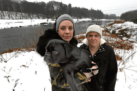 Debbie richmond, left, and her friend Susan Liebnitz who jumped into the river to save Lemmy the pug