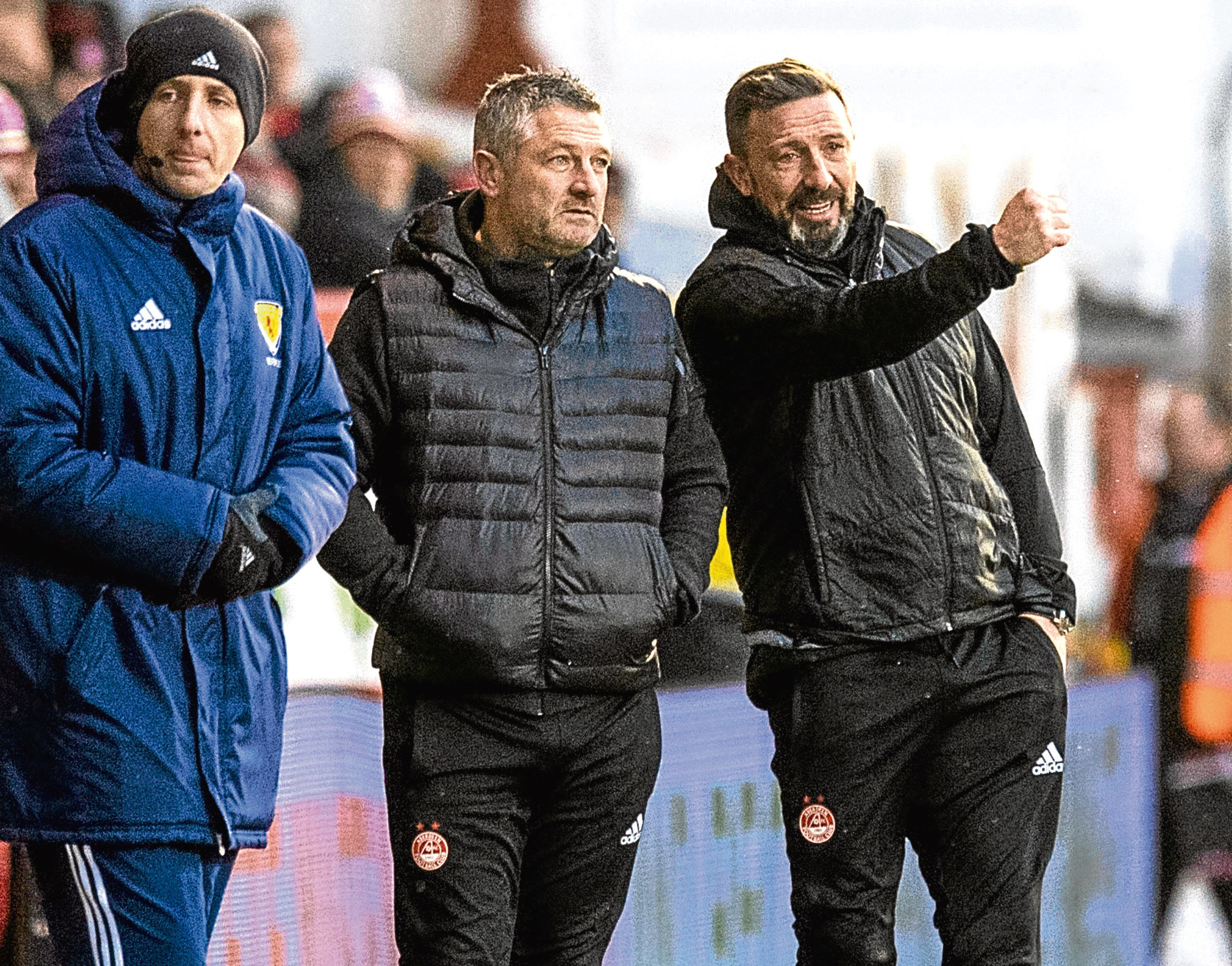 Aberdeen manager Derek McInnes and assistant manager Tony Docherty, middle.