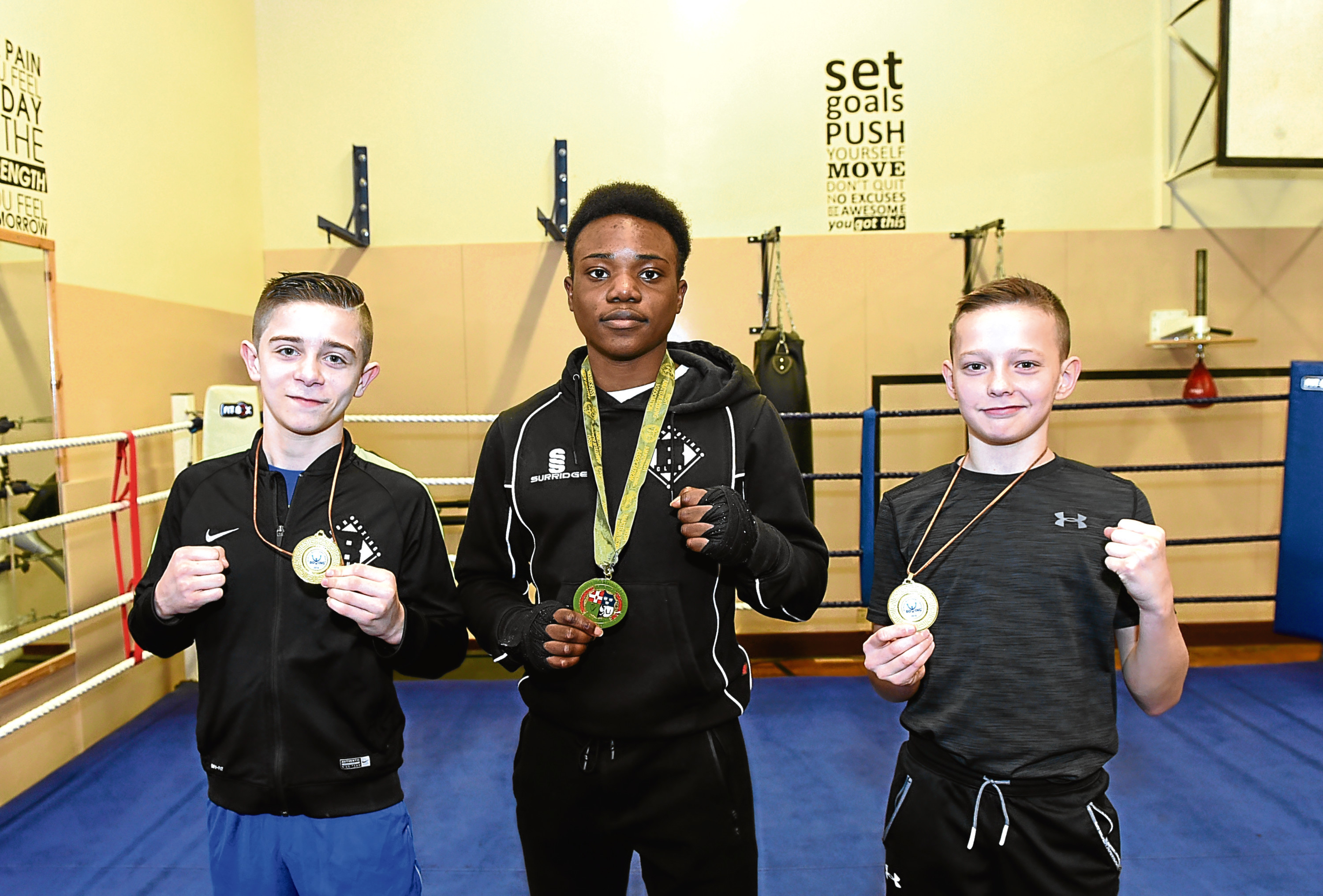 Willie Williamson, 13 , who won gold, Fawaz Aborode, 15, who won silver and Sonny Kerr who won gold.