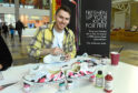 Artist Conzo Throb customised sneakers at the event