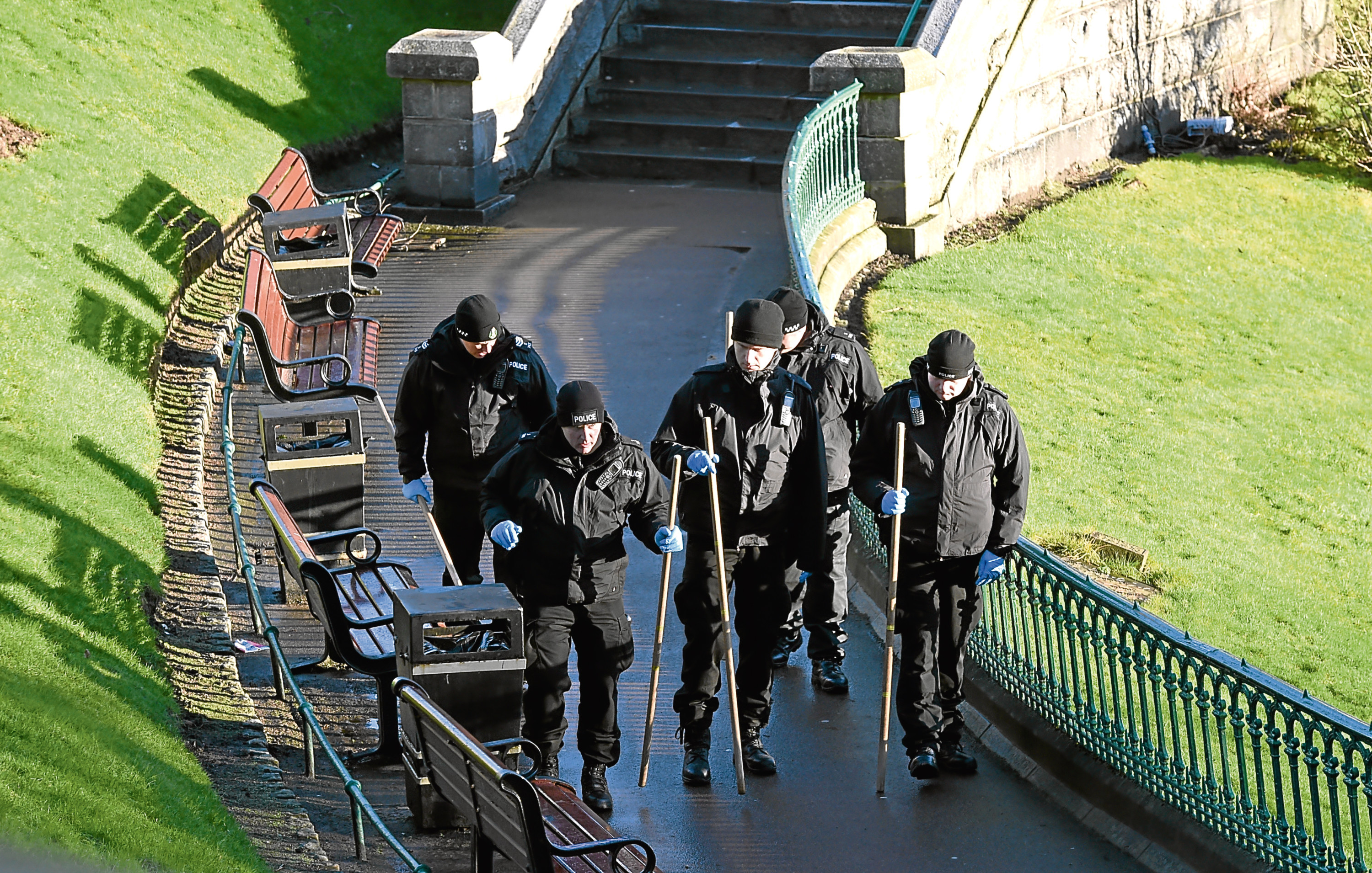 Police Scotland officers scour Union Terrace Gardens  following the attack in January 2016.