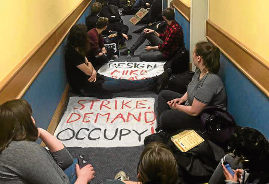 The students protesting in a corridor in the Regent Walk administration building at the University of Aberdeen.