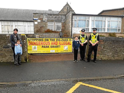 Head teacher Anne Craig, Pc David Ritchie and Sergeant Scott McKay with two Newburgh Mathers pupils.