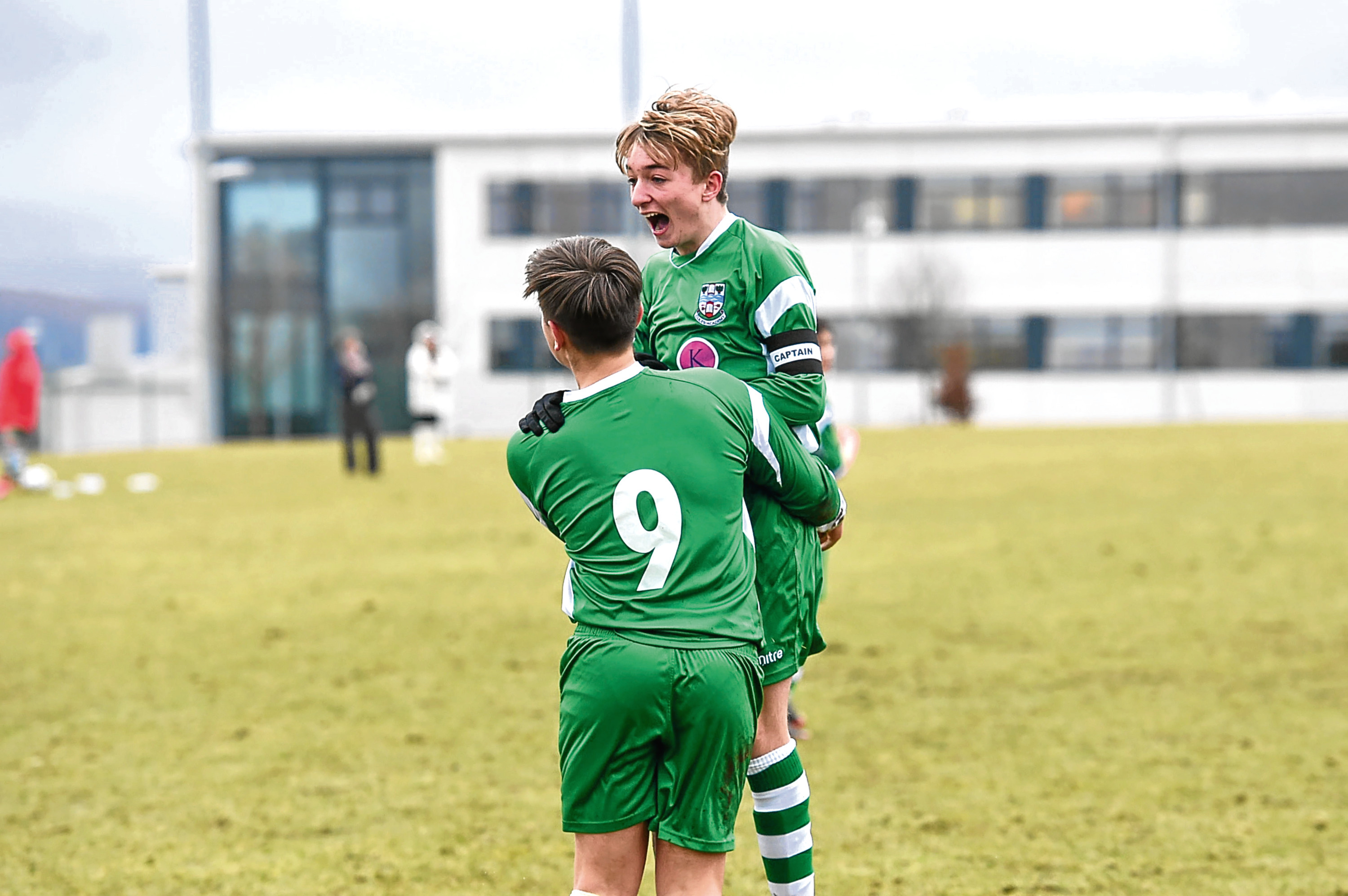 Pictured is Cults' Lewis Macdonald, 9, left, celebrating after scoring the opening goal of the game with captain Jordan Lynch. Picture by Darrell Benns