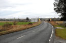 The A947 between Dyce and Newmachar.
