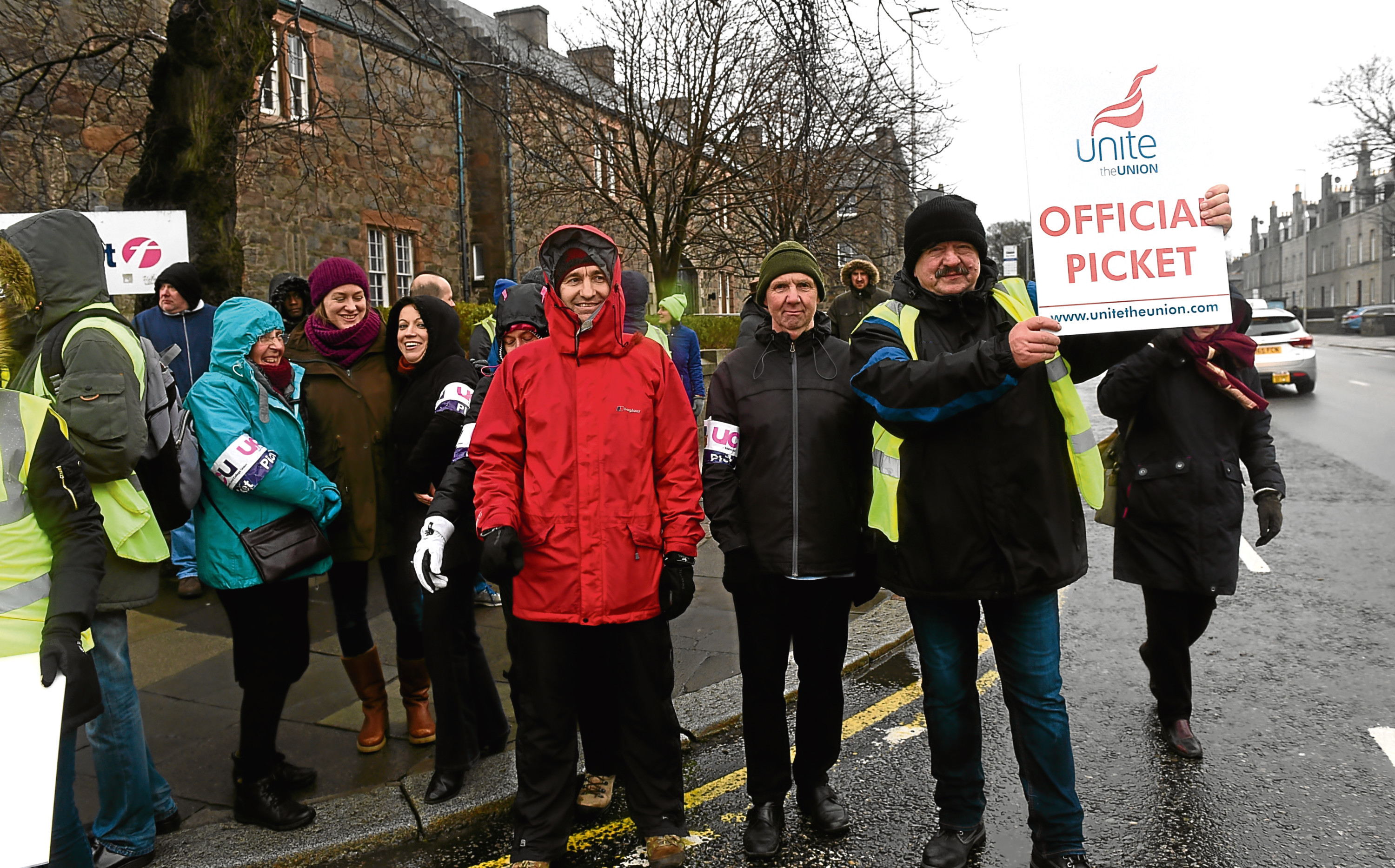 First Bus and University of Aberdeen lecturers striking together at the First Bus depot.