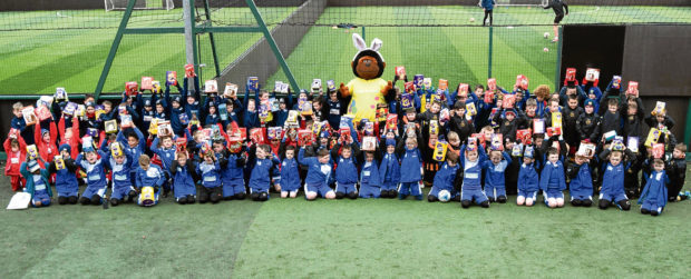 Giddy the Gorilla with the youth football teams who took part.