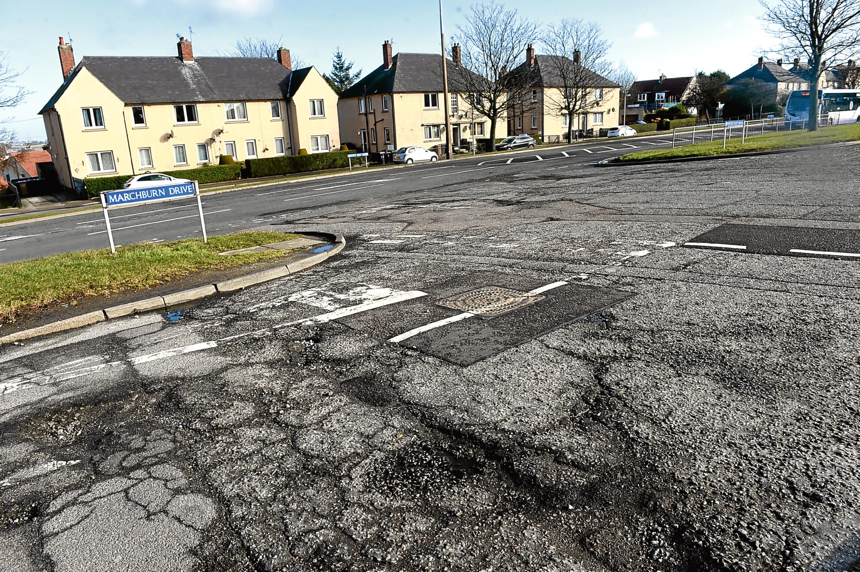 Potholes on Marchburn Road in Northfield.