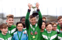 Pictured is Cults captain Harris Clubb holding the trophy with teammates. Picture by Darrell Benns