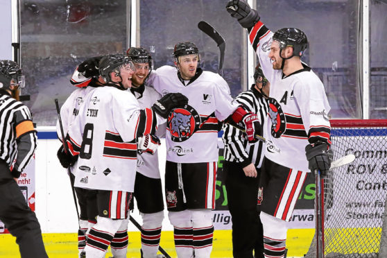 Aberdeen Lynx players celebrate with Novotony after he scored against Paisley Pirates in the first leg of the semi-final