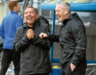 Peterhead manager Jim McInally shares a joke with assistant manager David Nicholls