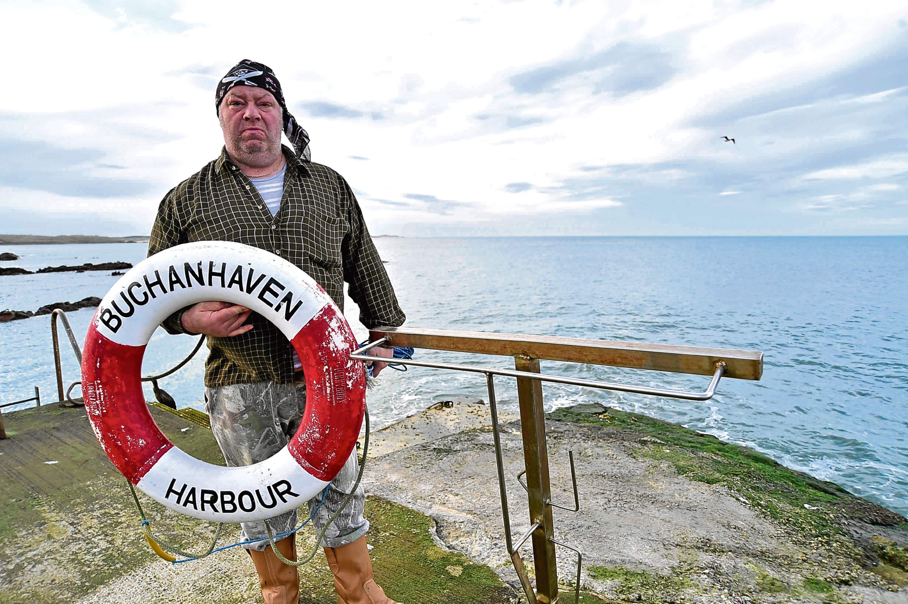 George Cameron from Buchanhaven Harbour with one of the two remaining lifebelts.
