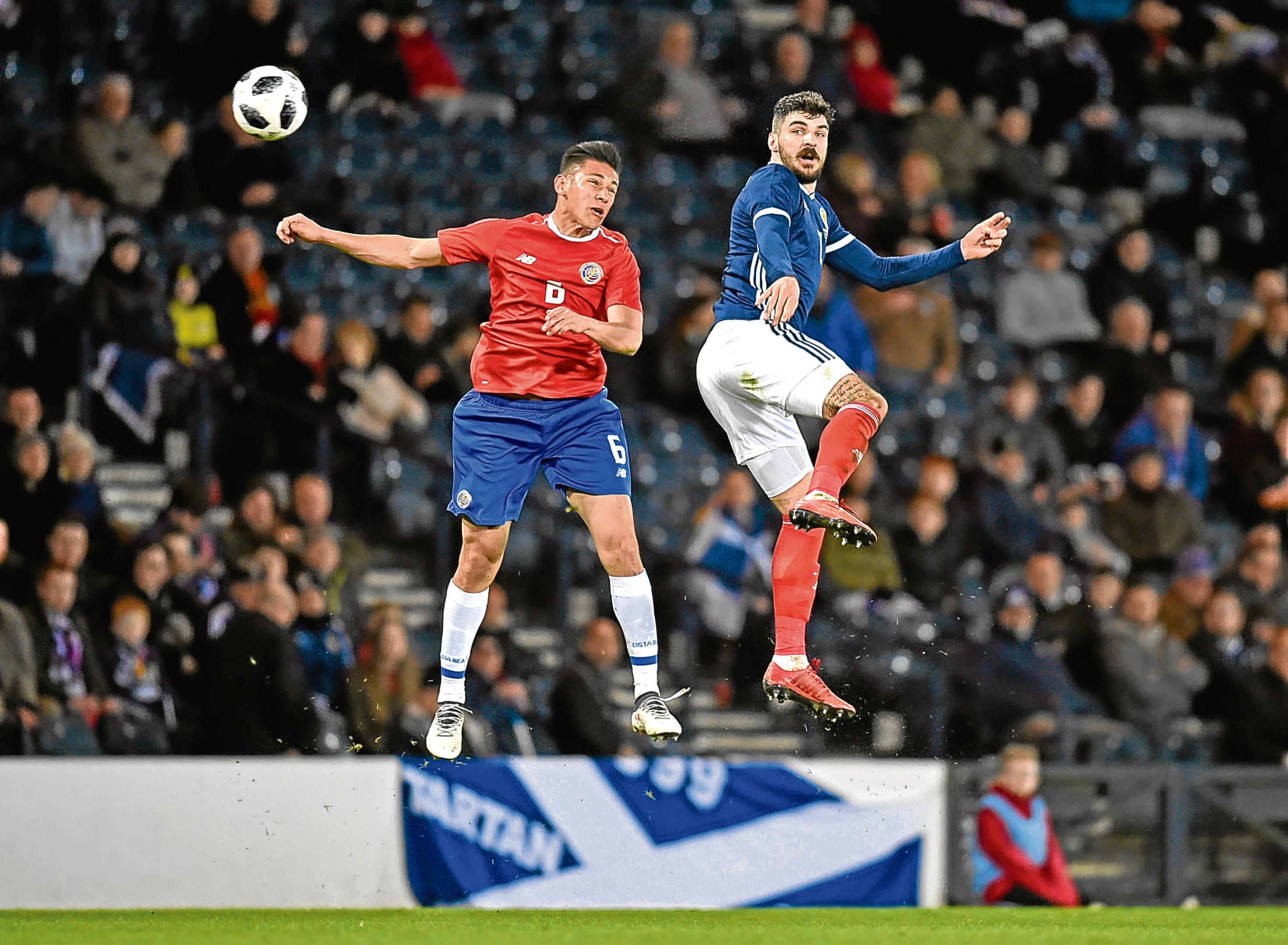 Scotland's Callum Paterson competes with Costa Rica's Oscar Duarte.
