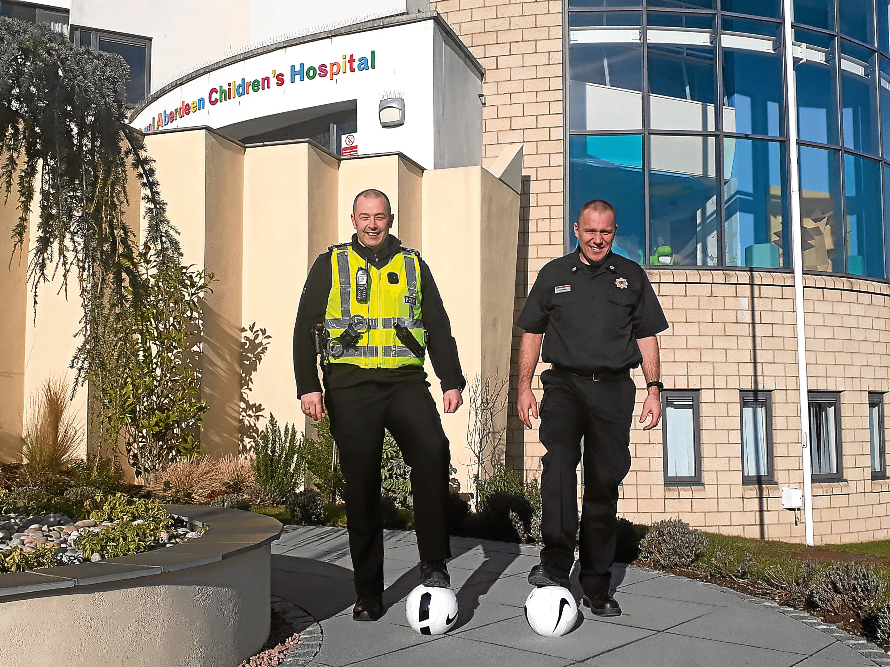 Firefighter Mike McNab and Police Scotland Inspector of Partnerships Colin Taylor.