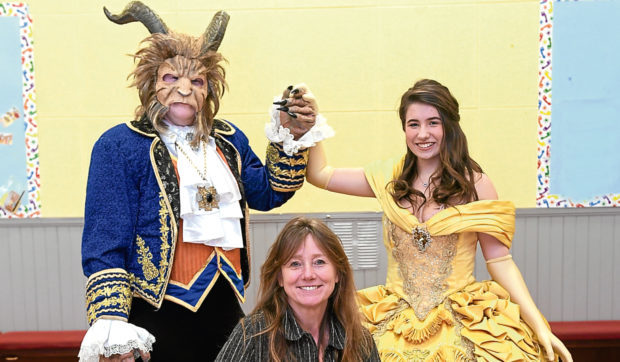 Director Shirley McGill is pictured with Sean Farmerey as the Beast and Stephanie Walker as Belle.