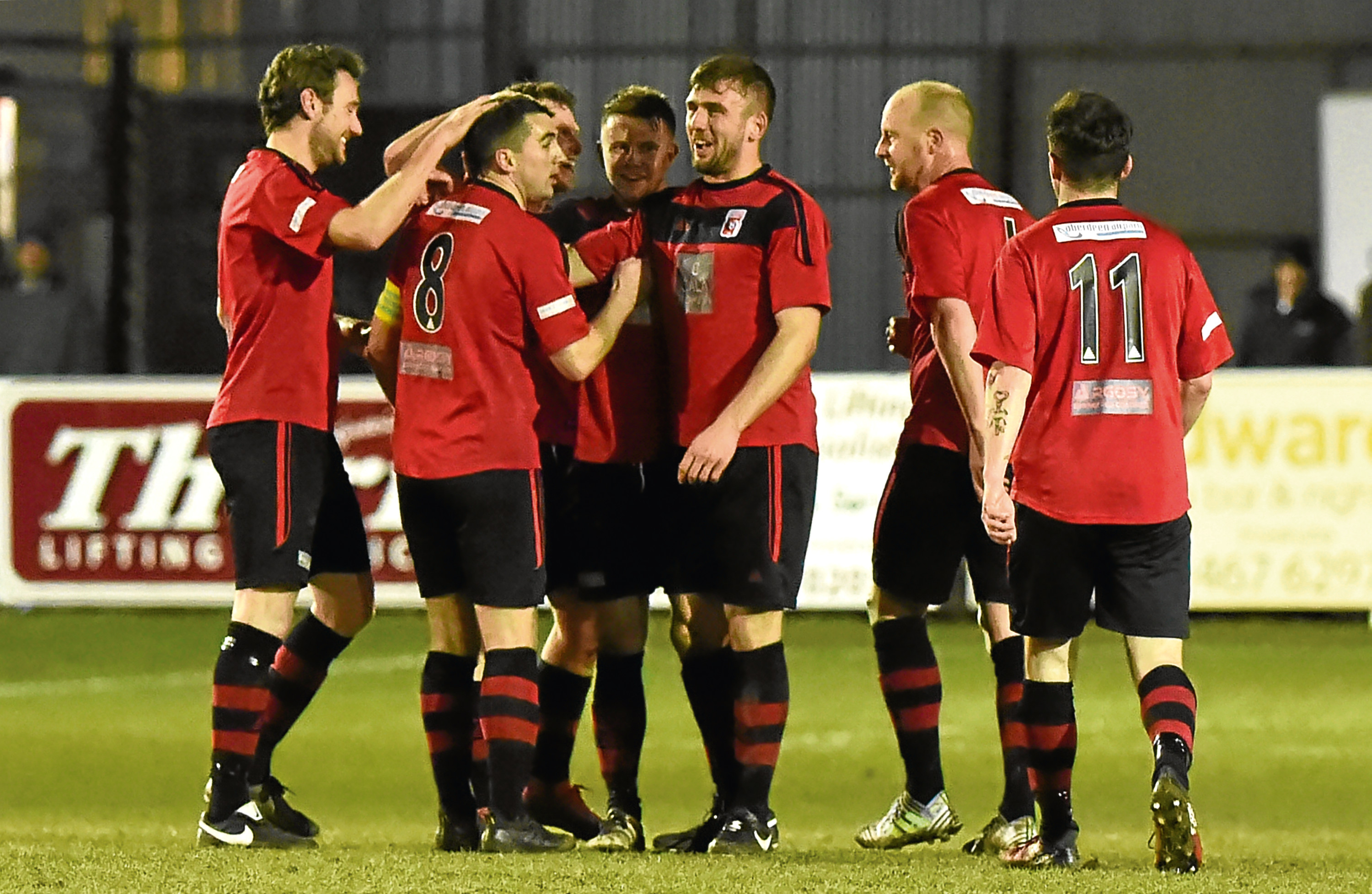 Neil McLean celebrating with team mates after scoring to make it 1-0.