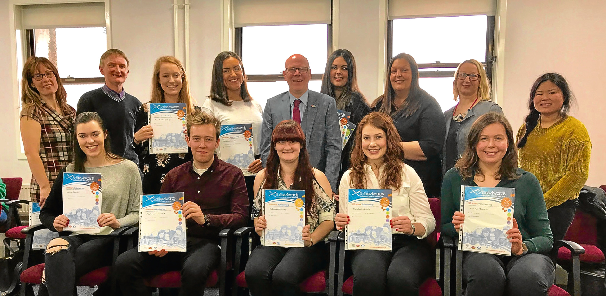 MSP Kevin Stewart and the Childline volunteers with their Saltire Awards.