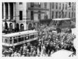 1928: A bus and a tram come to a halt on Union Street as people crane to see the Prince of Wales on a visit.