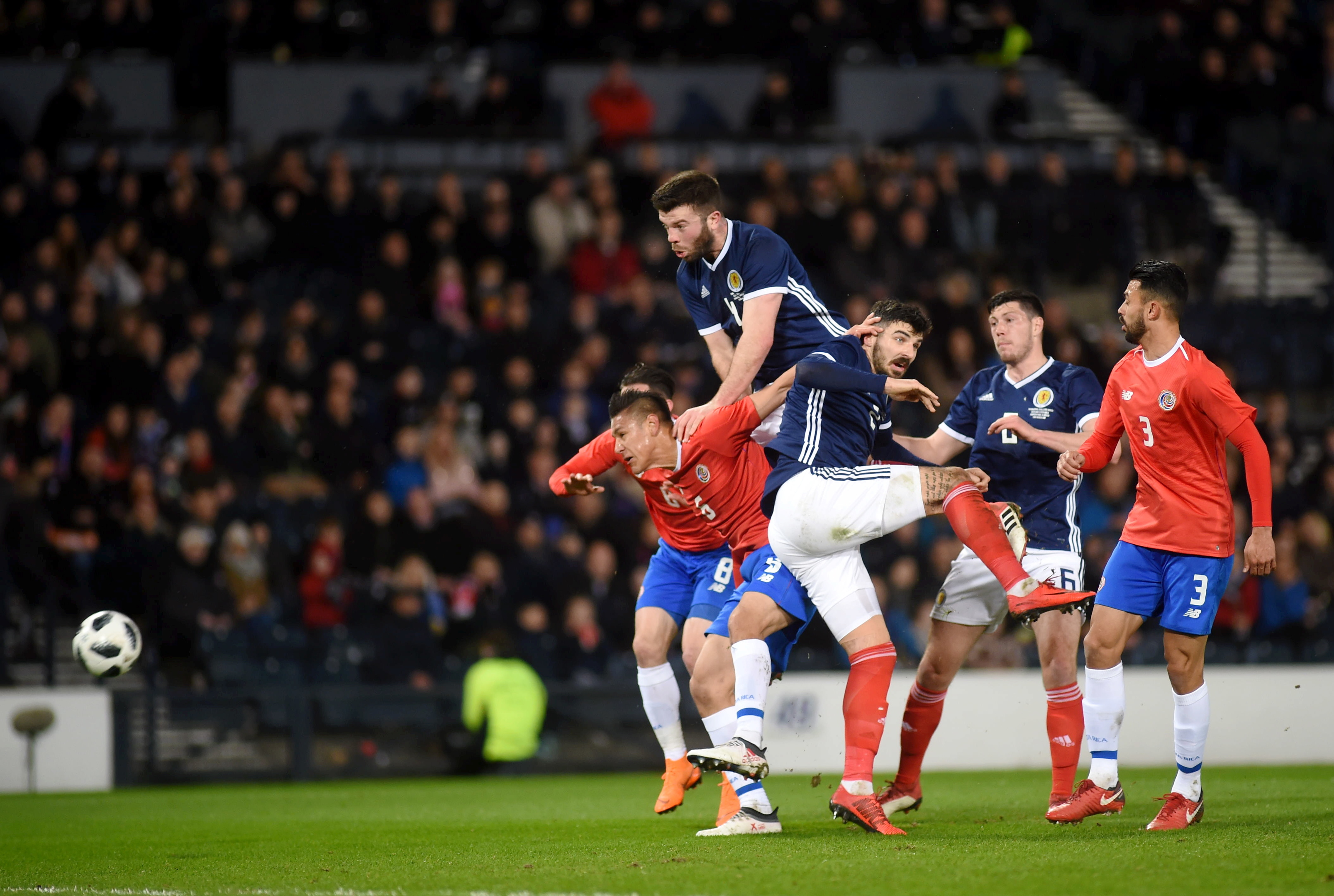 Scotland's Grant Hanley heading at goal.