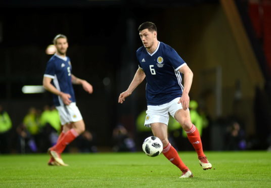 Aberdeen's Scott McKenna in action for Scotland.